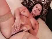 Mature brunette rubs her snatch