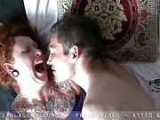 Redhead gets pleasure in bed