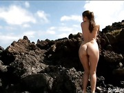 Nude Nicola on the rocks by the sea