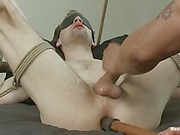 Tied gay slave gets his asshole dildoed